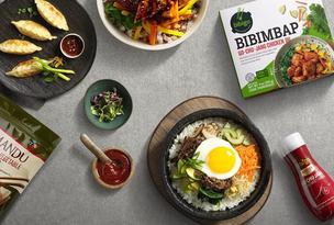 Bibimbap. Egg and vegetable salad on black ceramic bowl Food & Food Service CJ FOODS